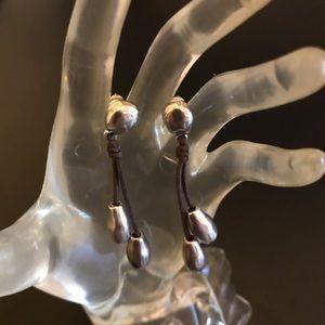 Uno de 50 silver earrings on leather rope